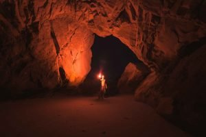 man-in-cave-with-candle